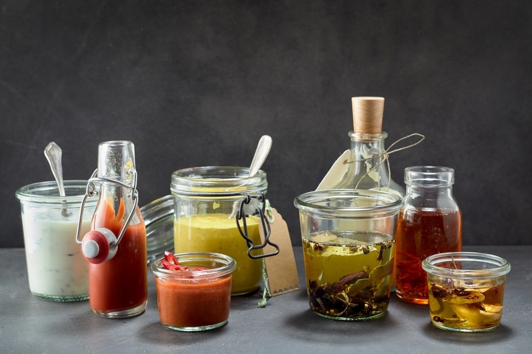 condiments in jars and bottles