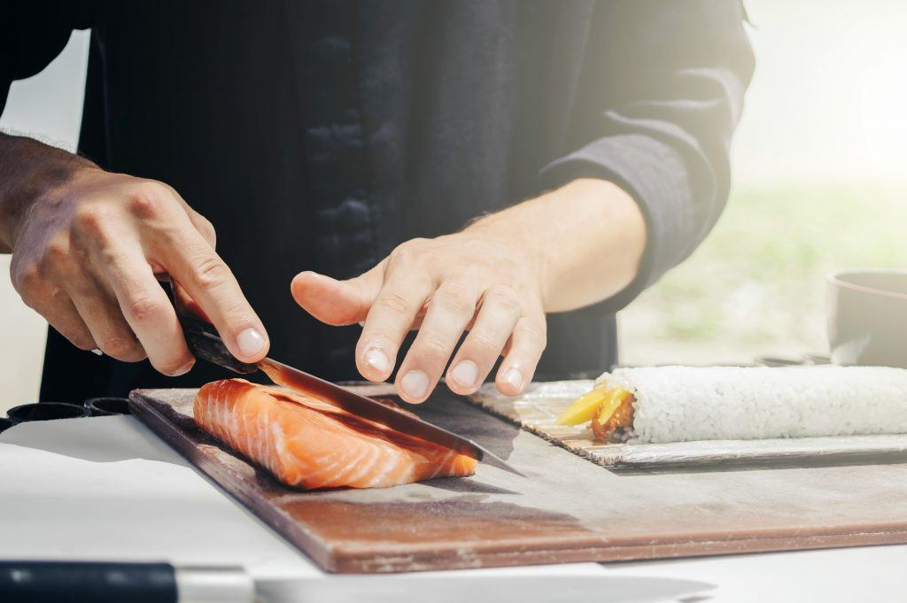 Chef cook making sushi outdoor